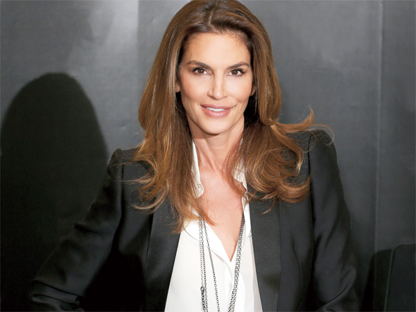 American supermodel Cindy Crawford, best known for being one of the five original supermodels discussed her new book and signed copies in Waterstones, London on September 2, 2015. 'Becoming' chronicles her life and career, as she prepares to turn 50 next February, and features some of her most memorable images
